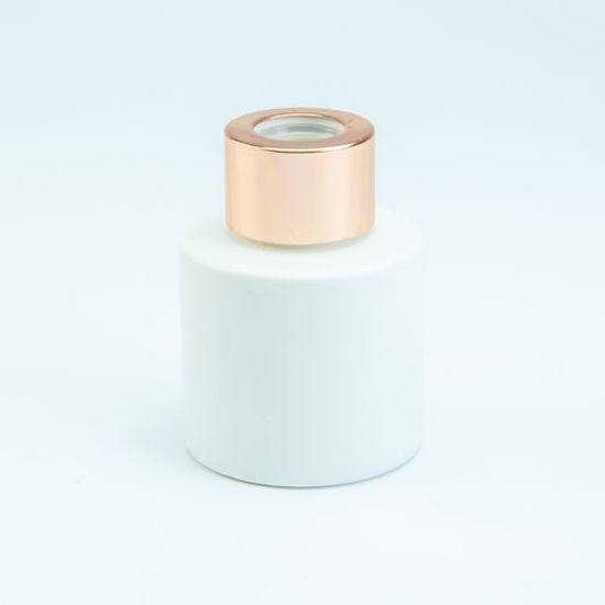 parfumflesje voor geurstokjes wit roze goud